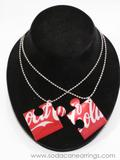 Puzzle piece necklaces hand made from recycled Coca-Cola can